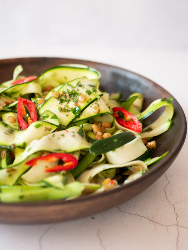 chimichurri courgette salad in a wooden bowl