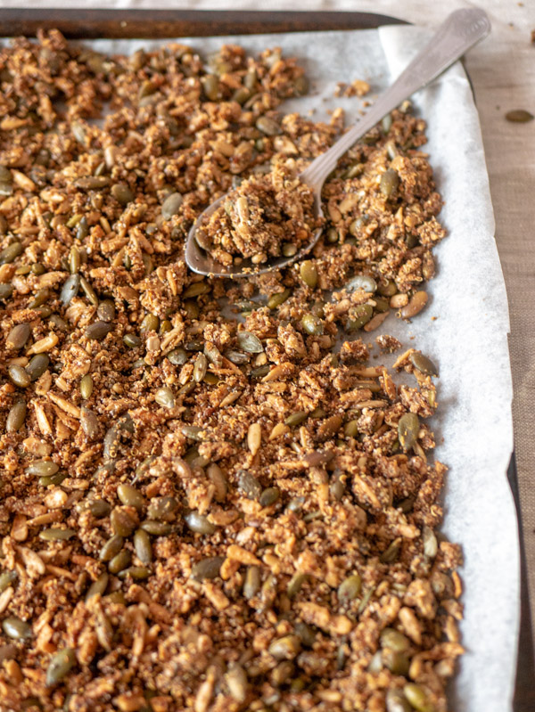 quinoa seed granola on a baking tray