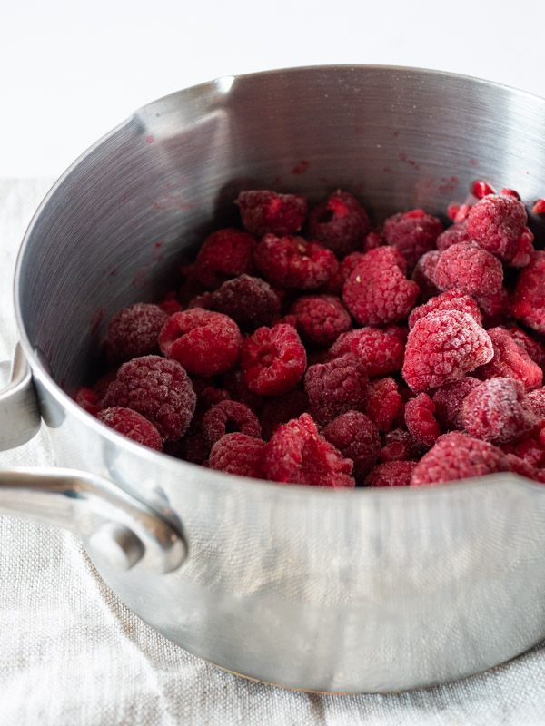 frozen raspberries in a silver saucepan