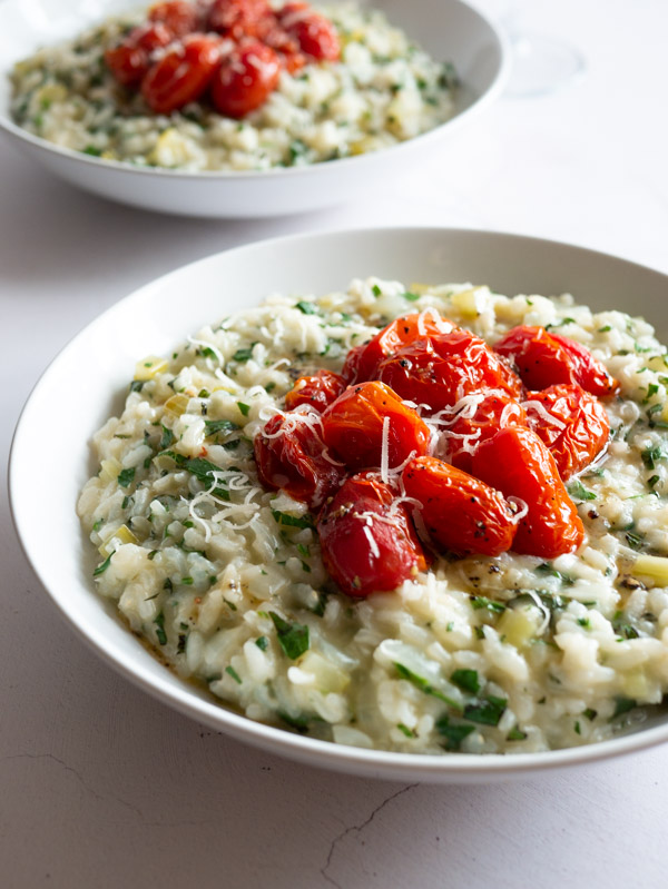 two bowls of Herby Tabbouleh Risotto with Roast Tomatoes