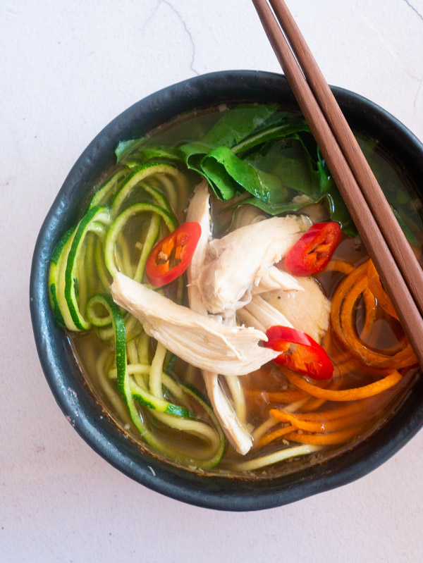 Asian Chicken and Vegetable Noodle Soup in a bowl with chopsticks