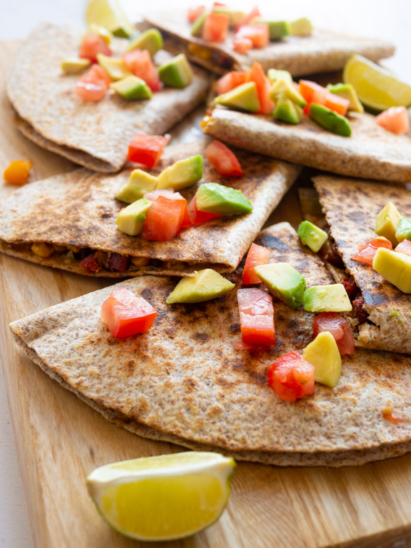6 quesadillas on a board with lime