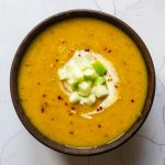 A bowl of spiced squash celeriac and apple soup