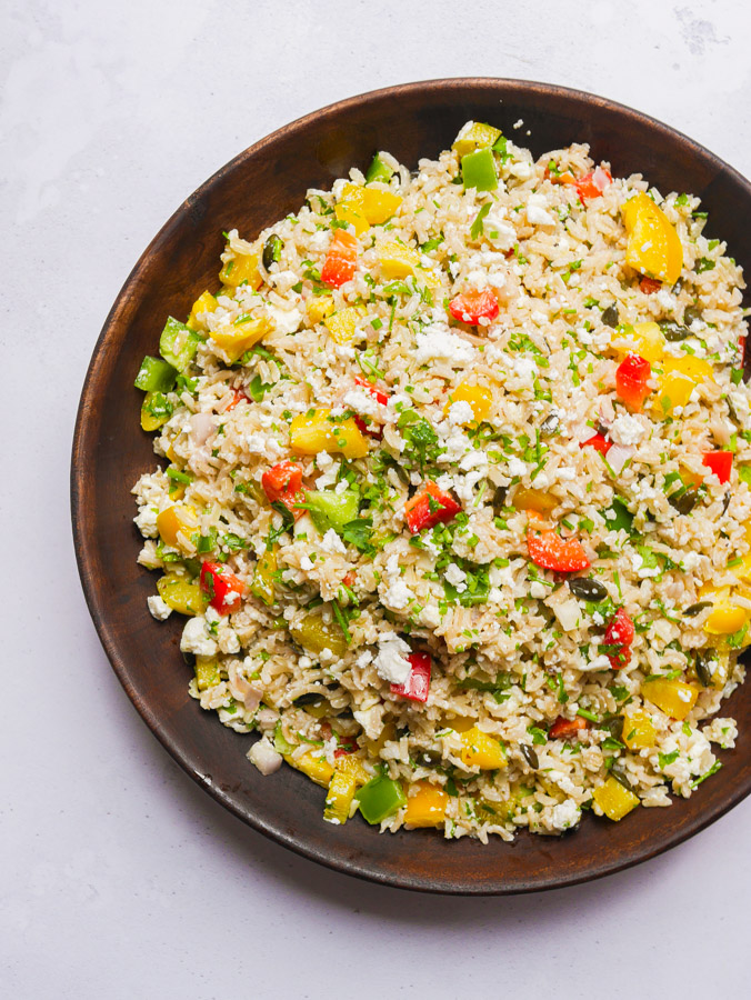Bell Pepper Rice Salad in a wooden bowl.