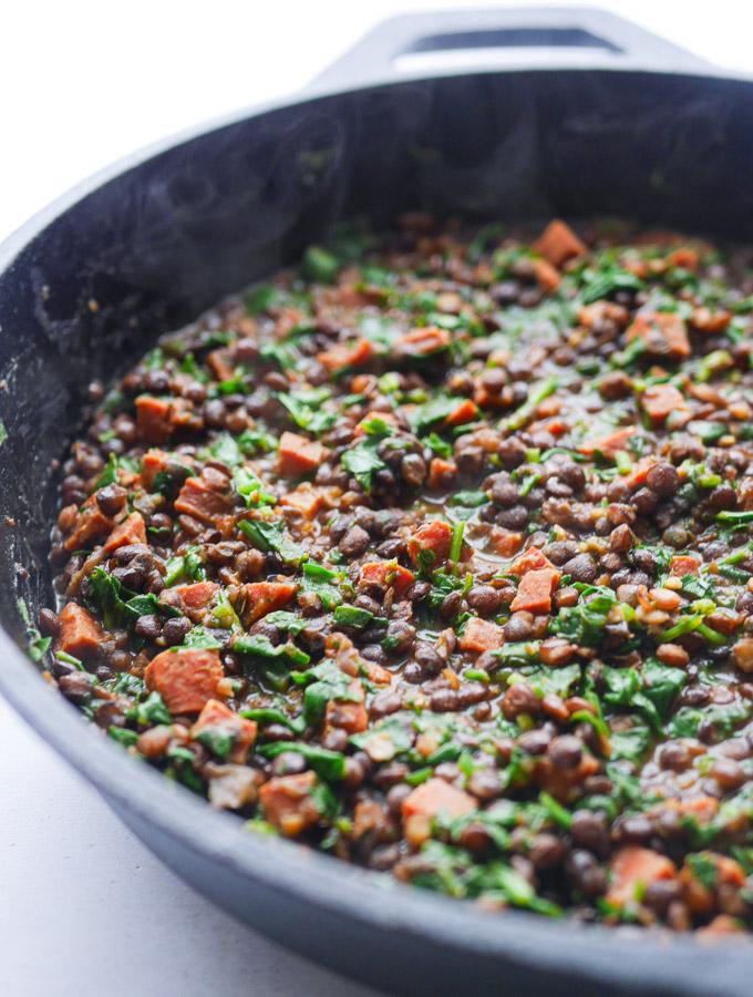 Chorizo & Lentil stew in a cast iron pan.